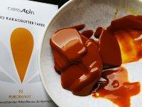BIO Kakaobutter gefärbt orange | Lebensmittelfarbe nat. (50g) Chips